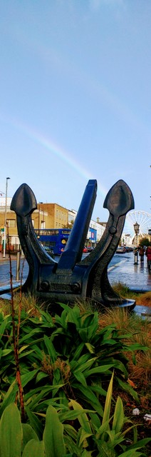 There is a long stretch of road from the watefront right through the spine of the city called the QE2 Mile - named for the royal cruise ship. This anchor for that might vessel rests here along - I caught a double-rainbow in the background :)