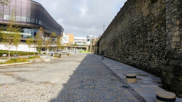21st century modern restaurants on the left... ancient Medieval defence walls on right